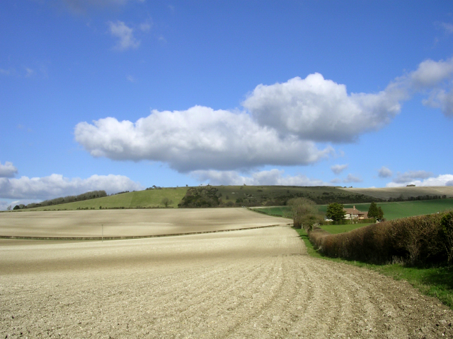 Ploughed chalk farmland with Old Winchester Hill in the distance