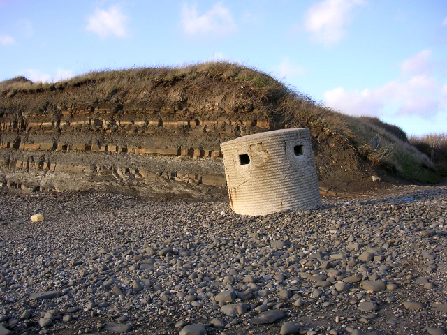 Cliff and concrete pillbox at Kimmeridge Bay beach