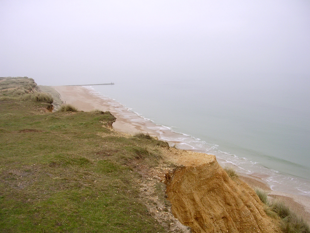 Unstable cliffs and long groyne at Hengistbury Head