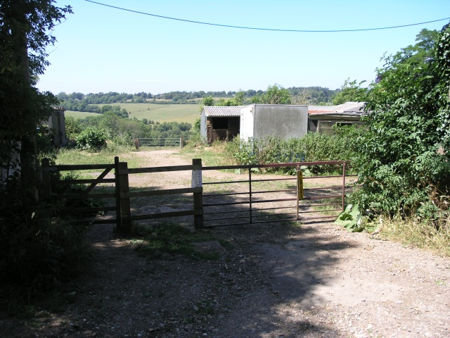 A gate with some farm buildings