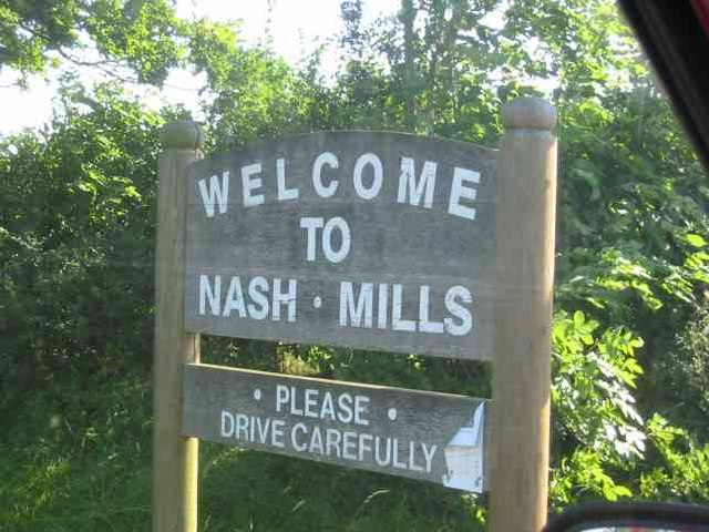 Village welcome sign to Nash Mills