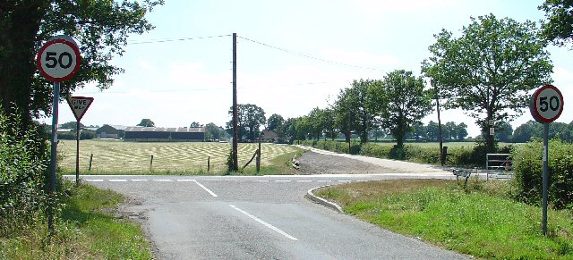 Road Junction of B2037 with minor road to Burstow. Newhouse Farm in the Background
