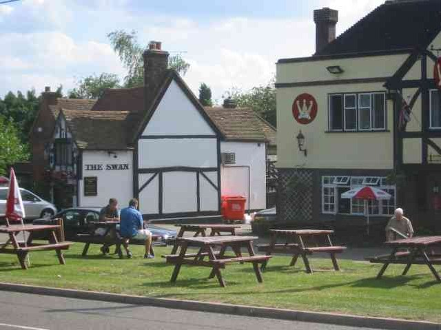 Two pubs opposite the common and the village sign Ley Hill