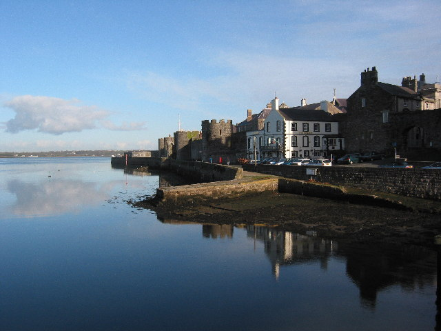 Caernarfon walled town, with Anglesey in the distance.
