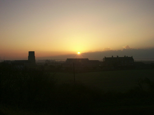 Church, tithe barn and Hall at sunset, Waxham