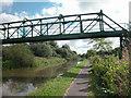 SJ4070 : Disused Footbridge and Pipeline by Dennis Turner
