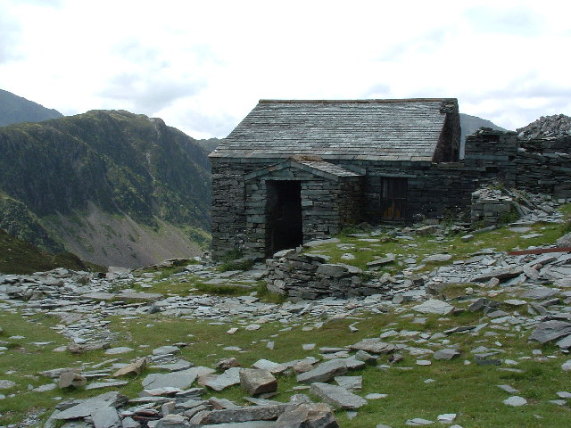 Mountain Bothy with Hay Stacks in background