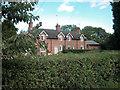 SJ4470 : Cottages on A56 by Dennis Turner