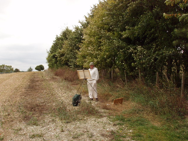 Artist with cornfield and hedge above Bledlow