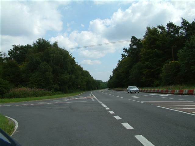 A4074 as it cuts through Three Cornered Wood