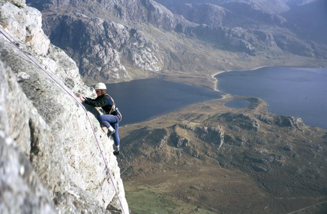 Climber on top pitch of Fionn Buttress