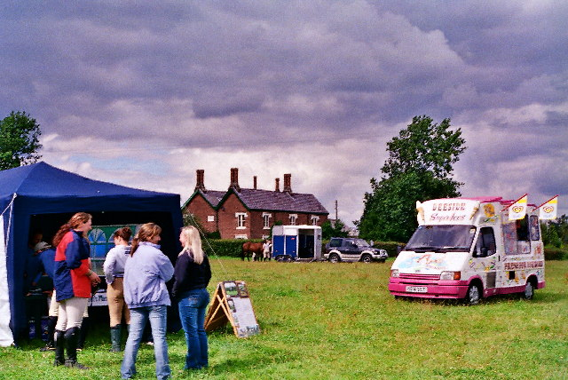 Horse Show in a Cheshire field under grey skies