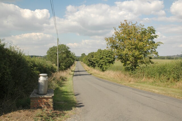 Milk churns by a country road