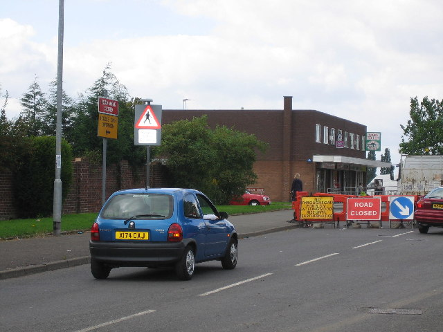 Shops and road works on Stroud Avenue, Willenhall
