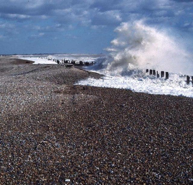 Waves breach the sea defences