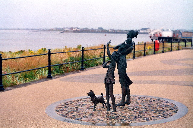 Statue on the prom at Fleetwood. Knott End slipway in the background
