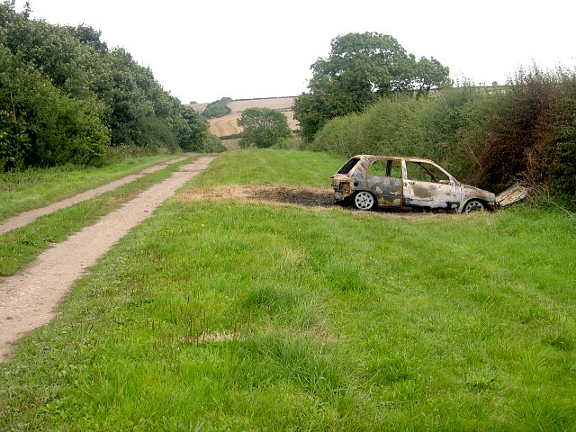 Bridleway through the valley and a burnt-out car