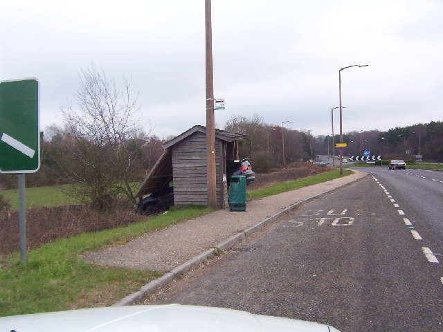 Bus stop and road approaching Faygate northbound