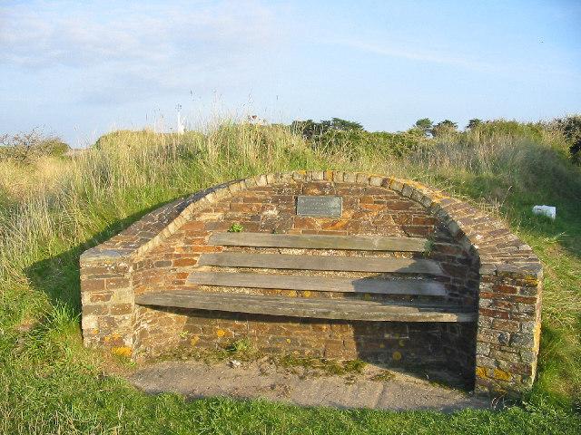 Memorial Seat beside footpath.