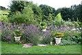 SW5828 : Pengersick farm - the gardens by Ken Ballinger