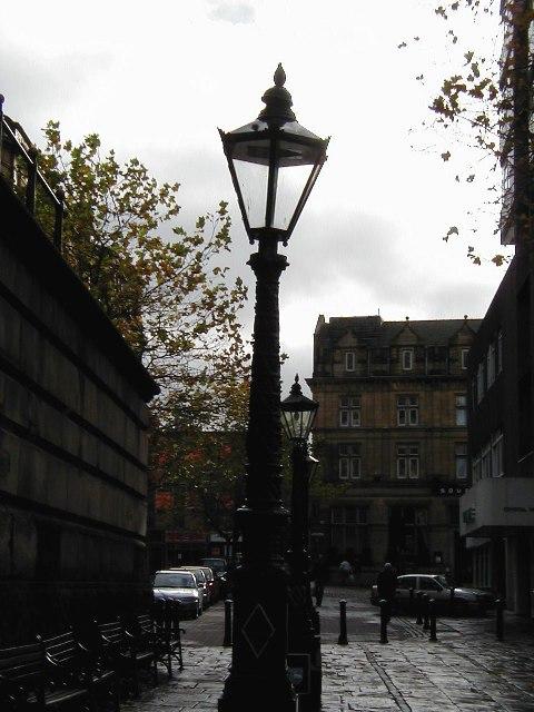 Cast iron lamp posts on Preston flag market