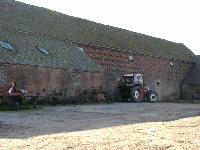 Massive barn and old machinery.
