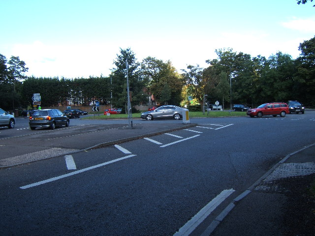 Roundabout at the junction of the A24 (right and foreground), A243 (ahead) and B2122 (left).