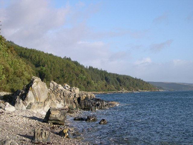 Forested hills and rocky beaches.