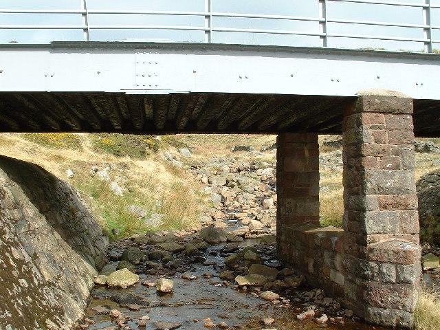 Buckbarrowbeck flowing under the Corney Fell road