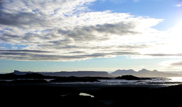 Eigg and Rum from the beach at Bunacaimb