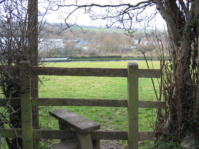 Stile and meadow running down to the Grand Union Canal