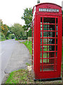 TQ5209 : Telephone box, Chalvington by Simon Carey