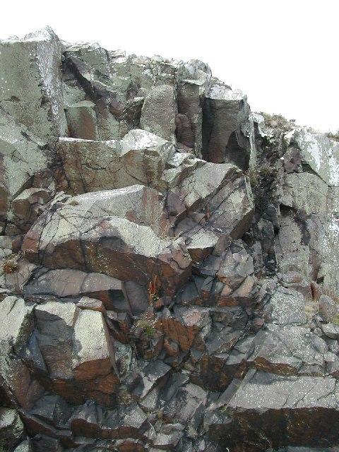 Lichen coated rock outcrop on Llyn coastal path