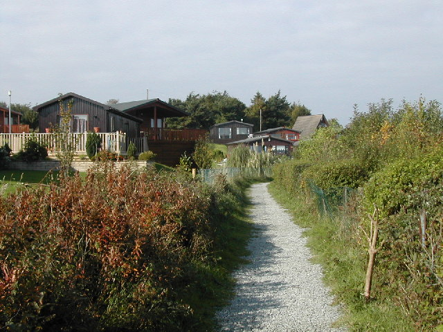 Footpath through Hafan Y Mor holiday park.