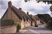 SK9211 : Thatched cottages at Exton by Humphrey Bolton