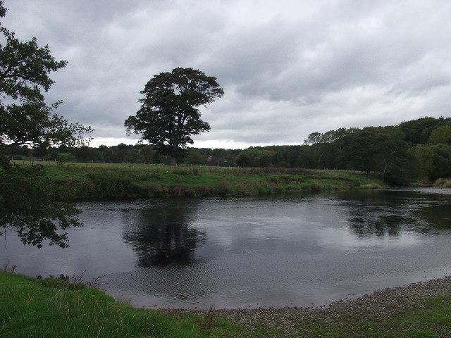 Afon Dyfrdwy circles its flood plain below Overton