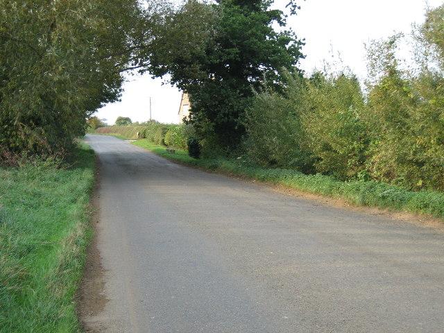 Road near Hawkwell Farm looking north-west