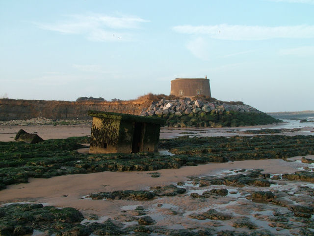 Martello Tower and an inverted Pillbox by the very eroded cliffs at East Lane, Bawdsey