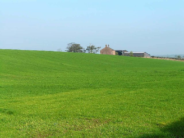 Thornby End farm, seen across open fields from the A596