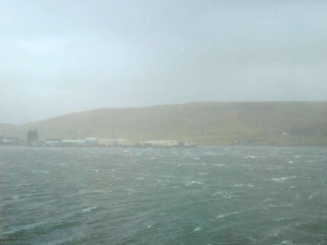 Scalloway harbour showing the castle as the highest building