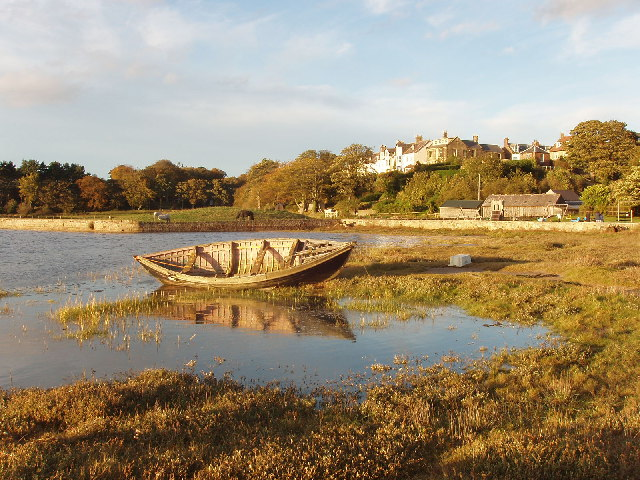 Boat and reflection in Alnmouth harbour