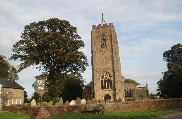 Emneth; village sign and parish church.