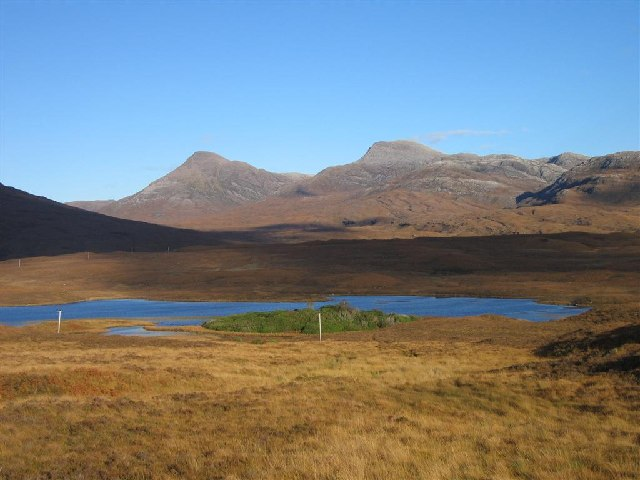 Maol Chean-dearg and An Ruadh-stac across Loch Coultrie on the A896