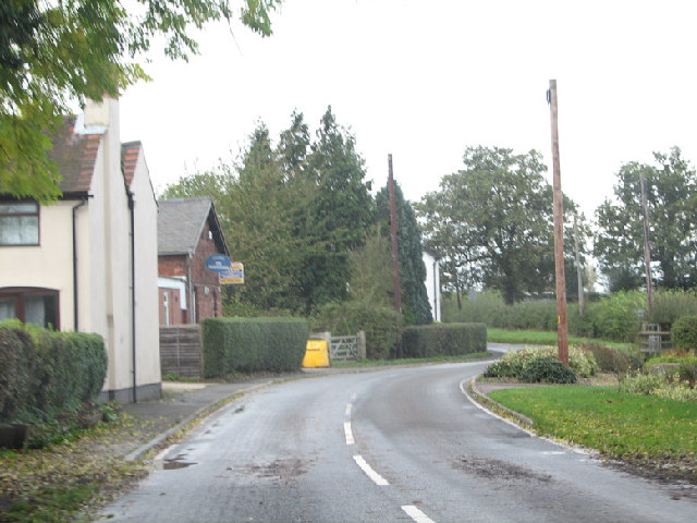 Wood End Lane, many a slipped wheel between road and garden.