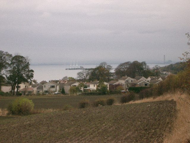 Farmland, houses and The Firth of  Forth.