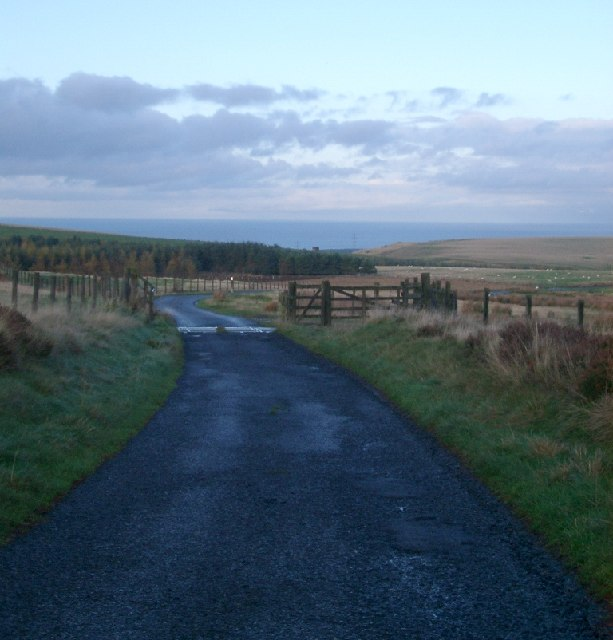 Cattle Grid and long view towards Ecclaw