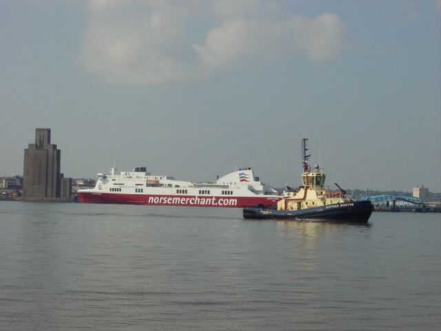 Irish Ferry at Wallasey Dock and Mersey Tugboat