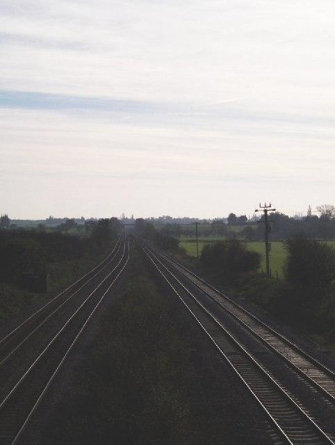 Mainline railway passing behind Milton Ernest