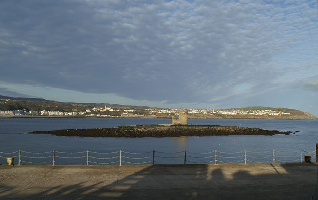 The Refuge on Conister or St. Mary's Rock in Douglas Bay, with Onchan Head behind
