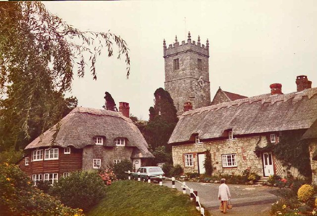 Cottages at Godshill with church in background.